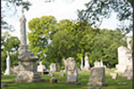 Elmwood Cemetery with grave stones and green trees